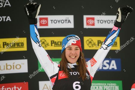 Bronze medalist Alizee Baron of France celebrates on the podium after the women's ski cross event at the freestyle ski and snowboard world championships, in Solitude, Utah