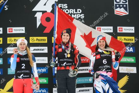 Fanny Smith Marielle Thompson Alizee Baron. Silver medalist Fanny Smith, left, of Switzerland, gold medalist Marielle Thompson, center, of Canada, and bronze medalist Alizee Baron, of France, celebrate on the podium after the women's ski cross event at the freestyle ski and snowboard world championships, in Solitude, Utah