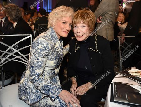 Glenn Close, Shirley MacLaine. Glenn Close, left, and Shirley MacLaine attend AARP The Magazine's 18th Annual Movies For Grownups Awards at Beverly Wilshire Hotel, in Beverly Hills, Calif