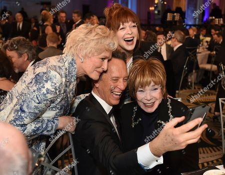 Stock Photo of Glenn Close, Richard E. Grant, Shirley MacLaine, Frances Fisher. Glenn Close, from left, Richard E. Grant, Shirley MacLaine and Frances Fisher attend AARP The Magazine's 18th Annual Movies For Grownups Awards at Beverly Wilshire Hotel, in Beverly Hills, Calif
