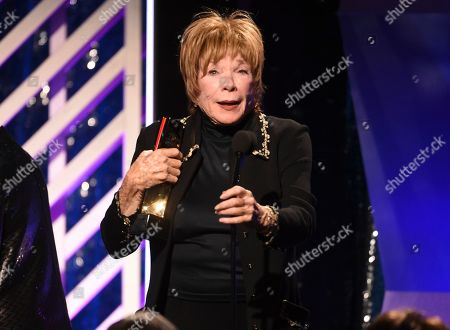 Stock Picture of Shirley MacLaine accepts the Career Achievement award during the 18th Annual Movies For Grownups Awards at Beverly Wilshire Hotel, in Beverly Hills, Calif