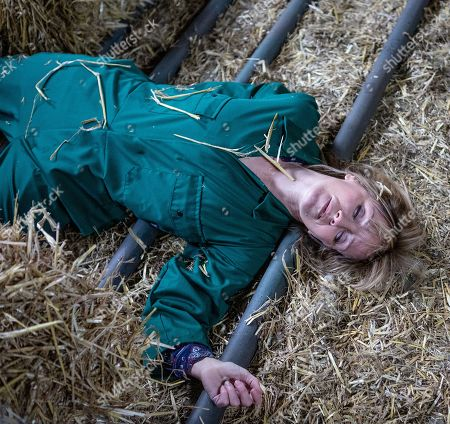 Ep 8399 Thursday 21st February 2019 - 1st Ep When Pete Barton finally arrives to work at the farm, Matty Barton's too caught up in moaning about Cain to pass on his warnings about the dodgy tractor. Now covering Vanessa's shift, Rhona Goskirk, as played by Zoe Henry, also arrives at the farm to check the cows. Unable to find them, Rhona phones Pete from the barn. Distracted by his ringing phone, Pete is horrified when the tractor he's driving brakes fail, and swerves into the barn. As the tractor crashes through, Rhona inside is knocked to the ground, lying unconscious and bleeding on the floor.