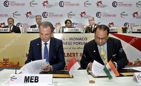 Stock Photo of Union Commerce and Industry Minister Suresh Prabhu and King Albert II looks on, as FICCI & Monaco Economic Board Sign MoU
