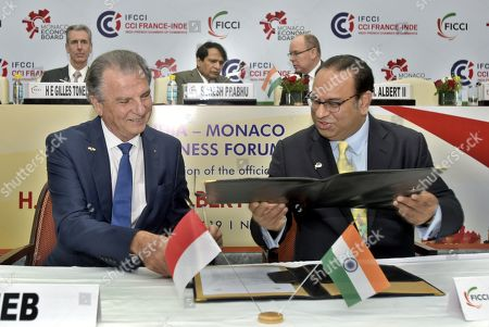 Stock Image of Union Commerce and Industry Minister Suresh Prabhu and King Albert II looks on, as FICCI & Monaco Economic Board Sign MoU