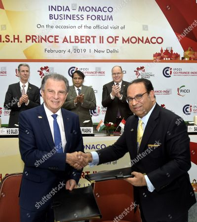 Union Commerce and Industry Minister Suresh Prabhu and King Albert II looks on, as FICCI & Monaco Economic Board Sign MoU