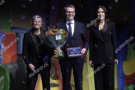 Crown Princess Mary presenting the cancer society's honour award 2018 in connection with World Cancer Day at the royal Danish playhouse in Copenhagen.  The recipients of the award became the 6 managers - Per Bank (Salling Group), Henrik Burkai (Rema 1000), Frederik Nielsen (Magasin Du Nord), Dirk Fust (Lidl Denmark), Peter Høgsted (Coop) and Finn Tang (ALDI).