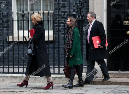 Andrea Leadsom, Leader of the House of Commons, Lord President of the Council, Baroness Evans of Bowes Park  Leader of the House of Lords, Lord Privy Seal, and Liam Fox, International Trade Secretary, leave the Cabinet Meeting.