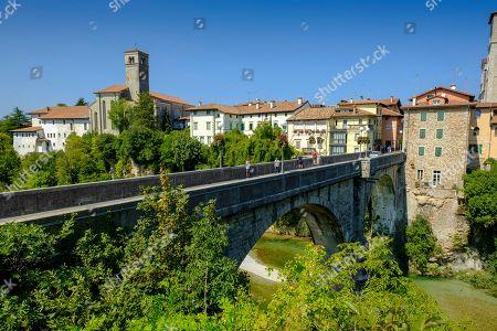 View over the river Natisone to the Campanile of the cathedral Santa Maria Assunta and the old town, Cividale del Friuli, Friuli Venezia Giulia, Italy