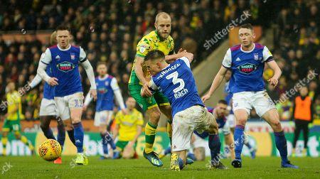 Teemu Pukki of Norwich City battles with Jonas Knudsen of Ipswich Town