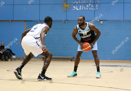 Tayo Ogedengbe of Surrey Scorchers with Ashley Hamilton of London Royals defending