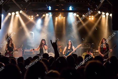 The American women's metal band The Iron Maidens, tribute band of the British heavy metal band Iron Maiden live in the Schueuer Lucerne, Switzerland vocals Kirsten Rosenberg drumset Linda McDonald guitar Courtney Cox guitar Nita Strauss