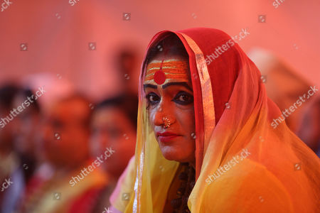 "Stock Image of Laxmi Narayan Tripathi, leader of the ""Kinnar Akhara"", a monastic order of the transgender community meets with followers at the Kumbh Mela festival in Pragraj, India, Tuesday, Feb.5, 2019. The Kumbh Mela is a series of ritual baths by Hindu holy men, and other pilgrims that dates back to at least medieval times"