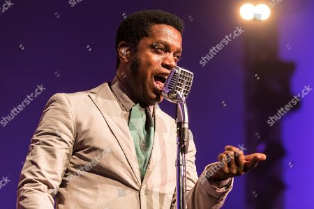 Stock Photo of The US-American Rhythm and Blues Band Vintage Trouble live at the Blue Balls Festival Lucerne, Switzerland Ty Taylor: Vocals Nalle Colt: Guitar Rick Barrio Dill: Bass Richard Danielson: Drums