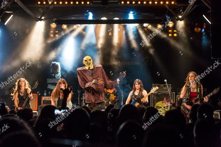Stock Photo of The American women's metal band The Iron Maidens, tribute band of the British heavy metal band Iron Maiden live in the Schueuer Lucerne, Switzerland vocals Kirsten Rosenberg drumset Linda McDonald guitar Courtney Cox guitar Nita Strauss