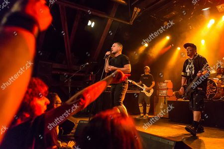 Stock Picture of The US-American hard rock band Ugly Kid Joe live in the Schueuer Lucerne, Switzerland vocals, Whitfield Crane guitar, Klaus Eichstadt drumset, Shannon Larkin guitar, Dave Fortman electric bass, Cordell Crockett