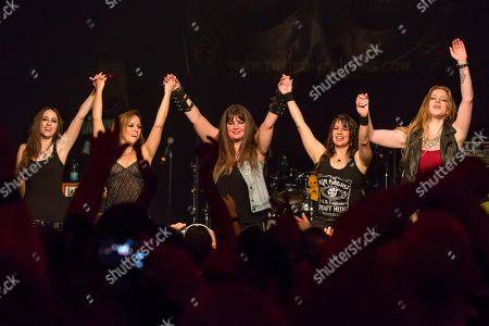 Stock Image of The American women's metal band The Iron Maidens, tribute band of the British heavy metal band Iron Maiden live in the Schueuer Lucerne, Switzerland vocals Kirsten Rosenberg drumset Linda McDonald guitar Courtney Cox guitar Nita Strauss