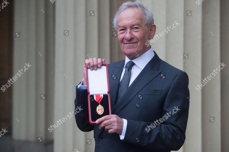Professor Sir Simon Schama, Historian and Broadcaster is awarded a Knighthood for services to History at Buckingham Palace, London