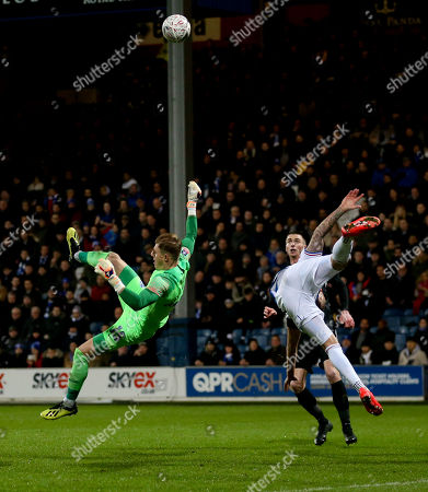 Grant Hall of QPR  and Portsmouth Goalkeeper Craig MacGillivray go flying after an battle for a high ball