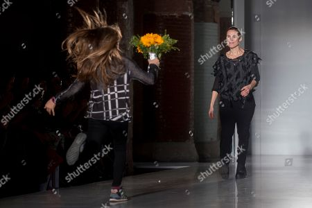 Stock Picture of Spanish designer Miriam Ponsa (R) greets the audience after the presentation of her creations during a fashion show at the 080 Barcelona Fashion event at Sant Pau center in Barcelona, northeastern Spain, 05 February 2019. The 080 fashion event runs from 04 to 07 February.