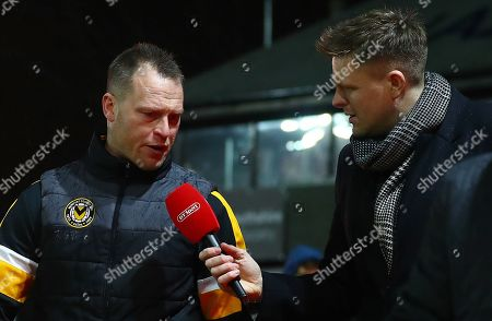 Newport County manager Michael Flynn is interviewed by BT sport presenter Jake Humphrey as he walks out for the second half