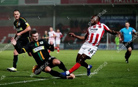 Alex Addai of Cheltenham Town is fouled by Tom James of Yeovil Town resulting in a red card.