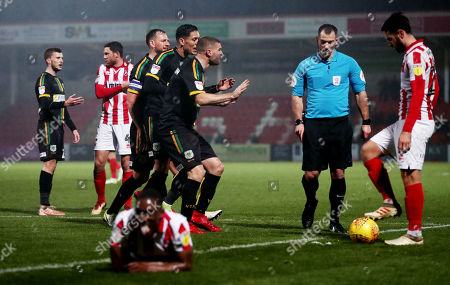 Yeovil players complain after Tom James of Yeovil Town is shown a red card.