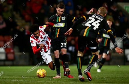 Jacob Maddox of Cheltenham Town is tackled by Tom James of Yeovil Town.