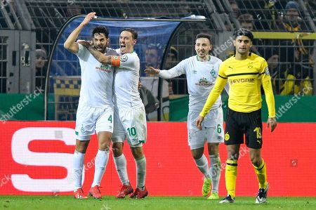Bremen's Claudio Pizarro, left, celebrates with Bremen's Max Kruse after scoring his side's second in overtime during the German soccer cup, DFB Pokal, match between Borussia Dortmund and Werder Bremen in Dortmund, Germany