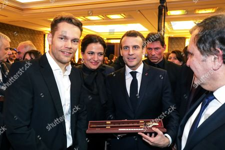 French President Emmanuel Macron (R) receives a gift from French businessman Nicolas Aznavour (L), son of late French-Armenian singer Charles Aznavour, during the Co-ordination Council of Armenian organisations of France (CCAF) annual dinner in Paris, France, 05 February 2019. The CCAF is the representative body of the French-Armenian Community.