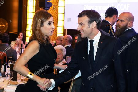 French President Emmanuel Macron (R) shakes hands with French-Lebanese journalist and TV host Lea Salame during the Co-ordination Council of Armenian organisations of France (CCAF) annual dinner in Paris, France, 05 February 2019. The CCAF is the representative body of the French-Armenian Community.
