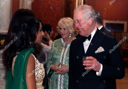 Stock Picture of Britain's Prince Charles and Camilla, Duchess of Cornwall meet former cricketer Isa Guha, at the British Asian Trust Dinner at Buckingham Palace in London, . This year's event will celebrate recent achievements of the British Asian Trust as well as heralding ambitious new plans to provide social impact at scale across South Asia and to acknowledge the role of key supporters