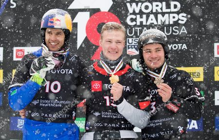 Stock Photo of Dmitry Loginov (C) of Russia, Roland Fischnaller (L) of Italy and Stefan Baumeister (R) of Germany celebrate their first second and third place finishes in the men's Snowboard Parallel Slalom at Park City Mountain Resort for the FIS World Championships in Park City, Utah, USA, 05 February 2019.