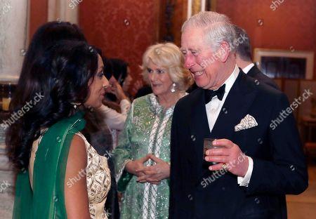 Britain's Prince Charles and Camilla Duchess of Cornwall meet former cricketer Isa Guha, at the British Asian Trust Dinner at Buckingham Palace.