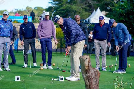 Pro golfer Davis Love III putts on an outdoor putting green during Chevron's 8th annual $100,000 Shoot-Out in the Champions vs Champions to kick off the AT&T National Pro-Am golf tournament, in Pebble Beach, Calif. Since 2013, Chevron has provided over $600,000 to local nonprofits and education organizations through this event