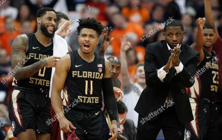 Florida State's David Nichols, center, leads the cheer from the bench during the second half of an NCAA college basketball game against Syracuse in Syracuse, N.Y., . Florida State won 80-62
