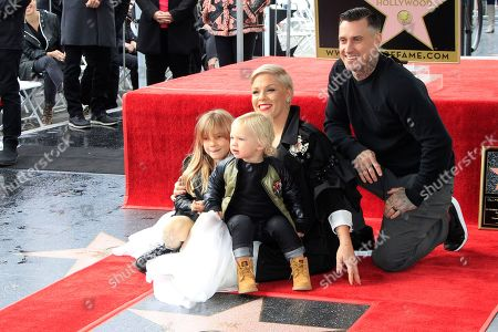 US singer Pink sits on her star with daughter Willow Sage Hart, son Jameson Moon Hart and husband Carey Hart as she receives the 2,656th Star on the Hollywood Walk of Fame in Hollywood, California, USA, 05 February 2019. The star was dedicated in the Category of Recording.