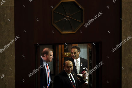 Rep. Emanuel Cleaver, D-Mo., right, arrives to hear President Donald Trump deliver his State of the Union address to a joint session of Congress on Capitol Hill in Washington