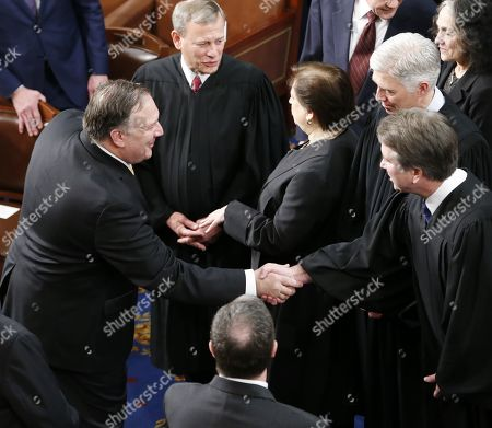US Secretary of State Mike Pompeo (L) shakes hands with Supreme Court Justice Brett M. Kavanaugh (R) as they wait for US rpesident Donald J. Trump to arrives to deliver his second State of the Union address from the floor of the House of Representatives on Capitol Hill in Washington, DC, USA, 05 February 2019.