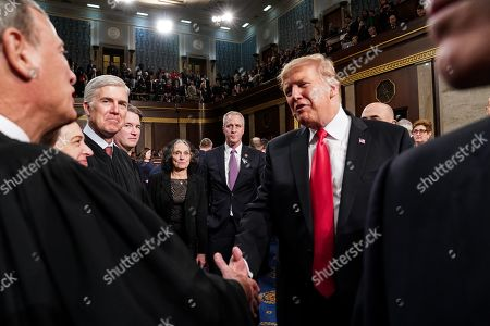 President Donald Trump shaking hands with Supreme Court Justice John Roberts after the State of the Union at the Capitol