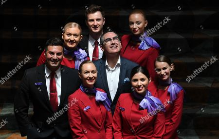 Newly appointed Virgin Australia Group Chief Executive Officer and Managing Director Paul Scurrah (C) poses for photographs with Virgin Australia cabin crew following a press conference to announce the appointment of the airline's new chief executive officer, in Sydney, Australia, 06 February 2019. Current CEO John Borghetti began working for Virgin Australia in 2010, and in June 2018 announced that he would step down.