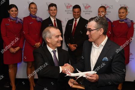 The new Virgin Australia Chief Executive Officer and Managing Director Paul Scurrah (R) and Current Virgin Australia Group CEO and Managing Director John Borghetti (L) pose for photographs with Virgin Australia cabin crew following a press conference to announce the appointment the airlines new chief executive officer, in Sydney, Australia, 06 February 2019. Current CEO John Borghetti began working for Virgin Australia in 2010, and in June 2018 announced that he would step down.