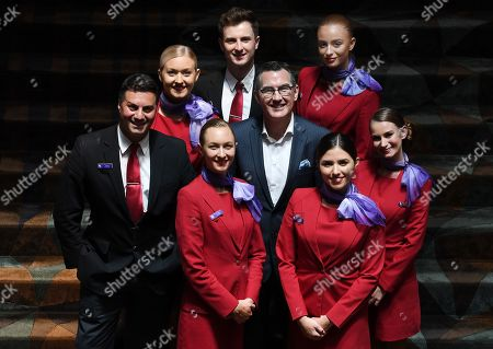Stock Image of Newly appointed Virgin Australia Group Chief Executive Officer and Managing Director Paul Scurrah (C) poses for photographs with Virgin Australia cabin crew following a press conference to announce the appointment of the airline's new chief executive officer, in Sydney, New South Wales, Australia, 06 February 2019. Current CEO John Borghetti began working for Virgin Australia in 2010, and in June 2018 announced that he would step down.