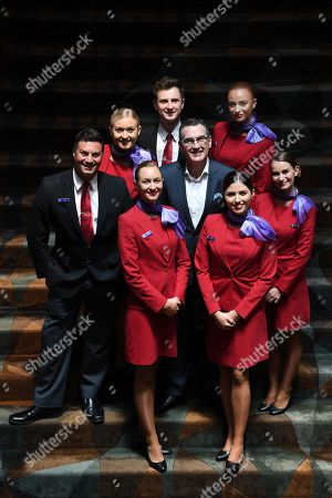 Newly appointed Virgin Australia Group Chief Executive Officer and Managing Director Paul Scurrah (C) poses for photographs with Virgin Australia cabin crew following a press conference to announce the appointment of the airline's new chief executive officer, in Sydney, New South Wales, Australia, 06 February 2019. Current CEO John Borghetti began working for Virgin Australia in 2010, and in June 2018 announced that he would step down.
