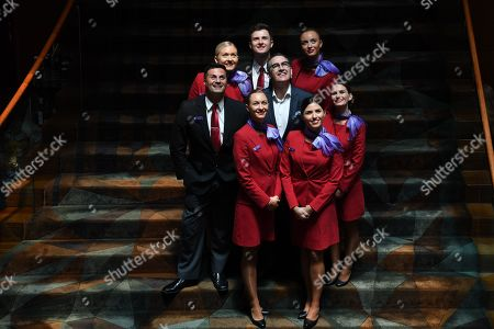 Stock Picture of Newly appointed Virgin Australia Group Chief Executive Officer and Managing Director Paul Scurrah (C) poses for photographs with Virgin Australia cabin crew following a press conference to announce the appointment of the airline's new chief executive officer, in Sydney, New South Wales, Australia, 06 February 2019. Current CEO John Borghetti began working for Virgin Australia in 2010, and in June 2018 announced that he would step down.