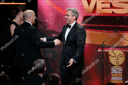 "Stock Picture of Actor Steve Carell wears a mask of his character ""Felonious Gru"" from the Minions movies as he presents the VES lifetime achievement award to CEO of Illumination Entertainment Chris Meledandri during the 17th annual VES Awards at the Beverly Hilton Hotel"