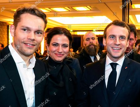 French President Emmanuel Macron, right, and French businessman Nicolas Aznavour, son of late French-Armenian singer Charles Aznavour, attend the annual dinner of the Co-ordination Council of Armenian organizations of France (CCAF), in Paris