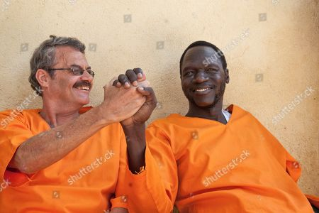James Gatdet Dak, William Endley. James Gatdet Dak, right, the longtime spokesman of opposition leader Riek Machar, clasps hands with William Endley, left, a South African former defense colonel who also worked with the opposition, as they prepare to be released from prison after their death sentence was pardoned, in Juba, South Sudan. Dak, one of the highest-profile detainees during South Sudan's five-year civil war, has shared his account with The Associated Press, after his release under a fragile peace deal signed in September