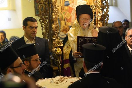 """Greece's Prime Minister Alexis Tsipras, left, attends a church service by Ecumenical Patriarch Bartholomew I at the Theological School of Halki, in Heybeli Island, near Istanbul,. The president of Turkey and the prime minister of Greece agreed Tuesday on the need to keep """"channels of dialogue"""" open between their countries, which have come to the brink of war three times since the early 1970s and remain divided over an array of issues"""