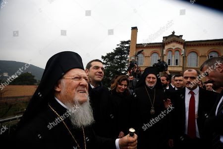 """Stock Picture of Greece's Prime Minister Alexis Tsipras, second left, and Ecumenical Patriarch Bartholomew I, left, visit the Theological School of Halki, in Heybeli Island, near Istanbul,. The president of Turkey and the prime minister of Greece agreed Tuesday on the need to keep """"channels of dialogue"""" open between their countries, which have come to the brink of war three times since the early 1970s and remain divided over an array of issues"""