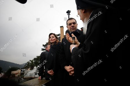 """Greece's Prime Minister Alexis Tsipras, center, his partner Betty Baziana and Ecumenical Patriarch Bartholomew I, right, visit the Theological School of Halki, in Heybeli Island, near Istanbul,. The president of Turkey and the prime minister of Greece agreed Tuesday on the need to keep """"channels of dialogue"""" open between their countries, which have come to the brink of war three times since the early 1970s and remain divided over an array of issues"""